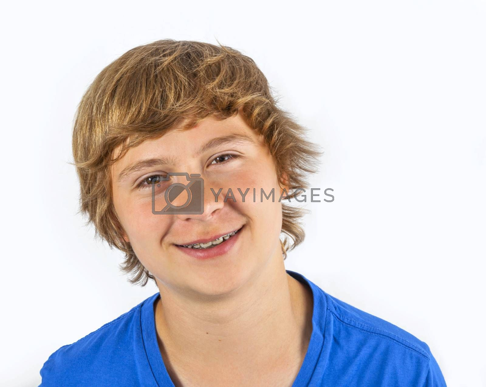 cute handsome boy with blue shirt enjoys posing