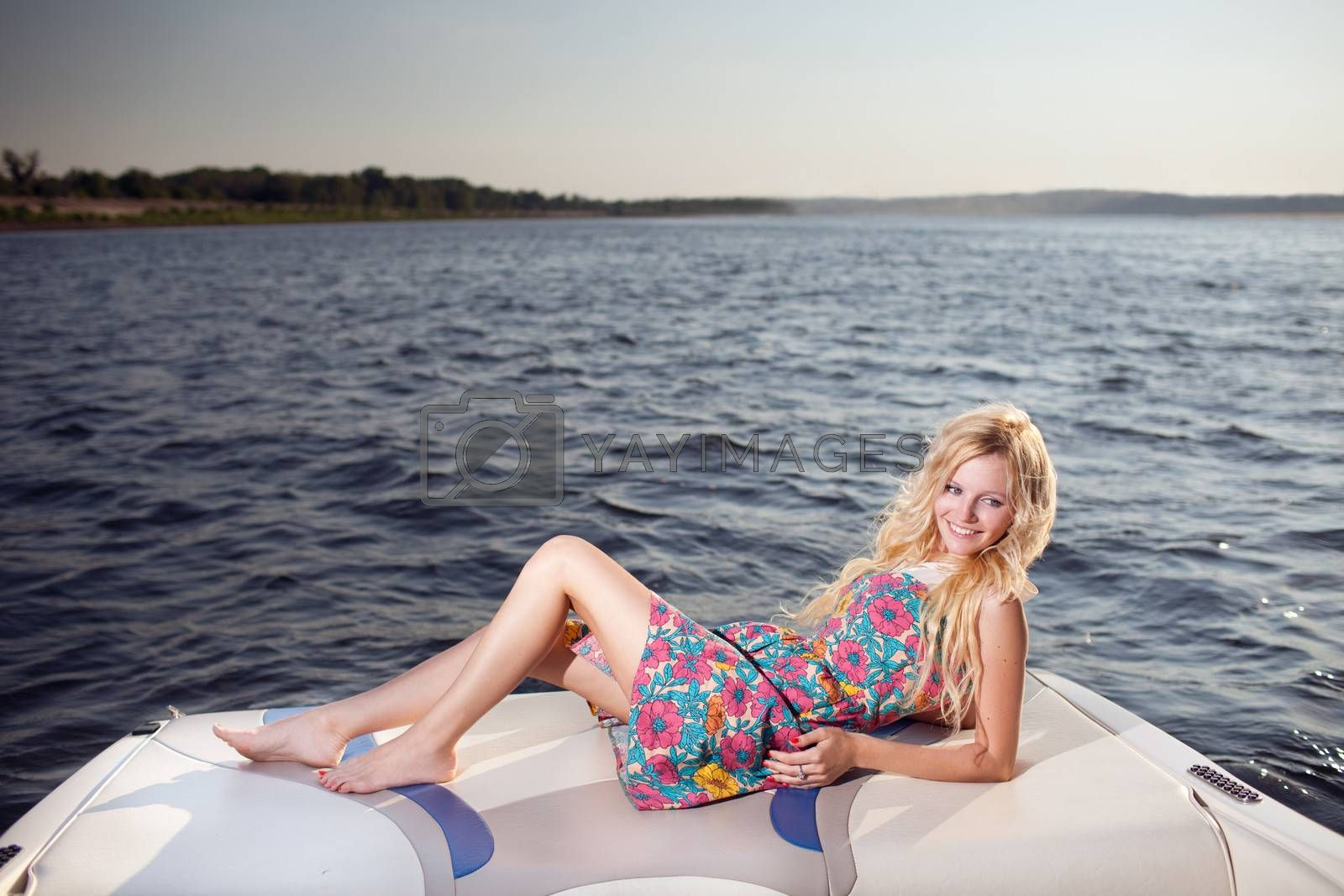 young happy girl on the boat