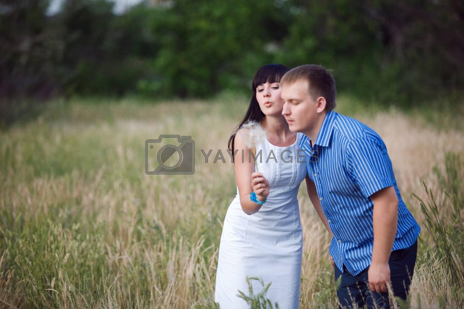 couple with dandelion