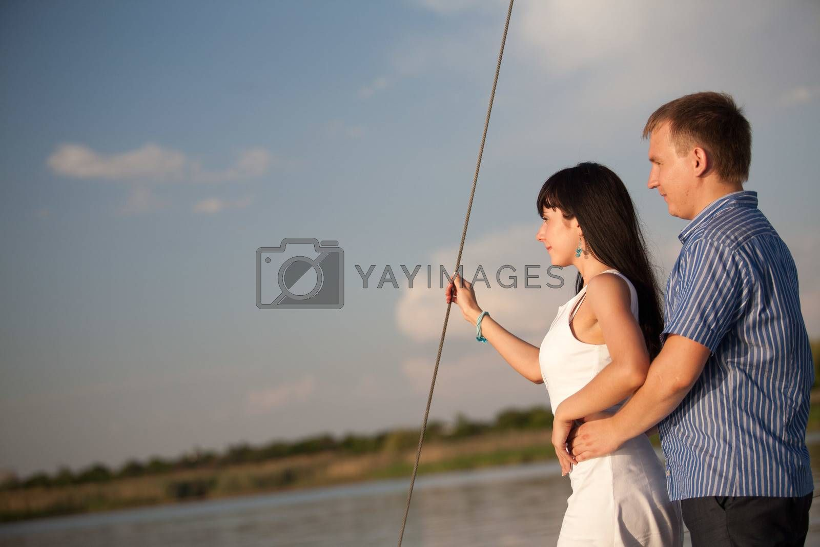 young happy couple on the boat