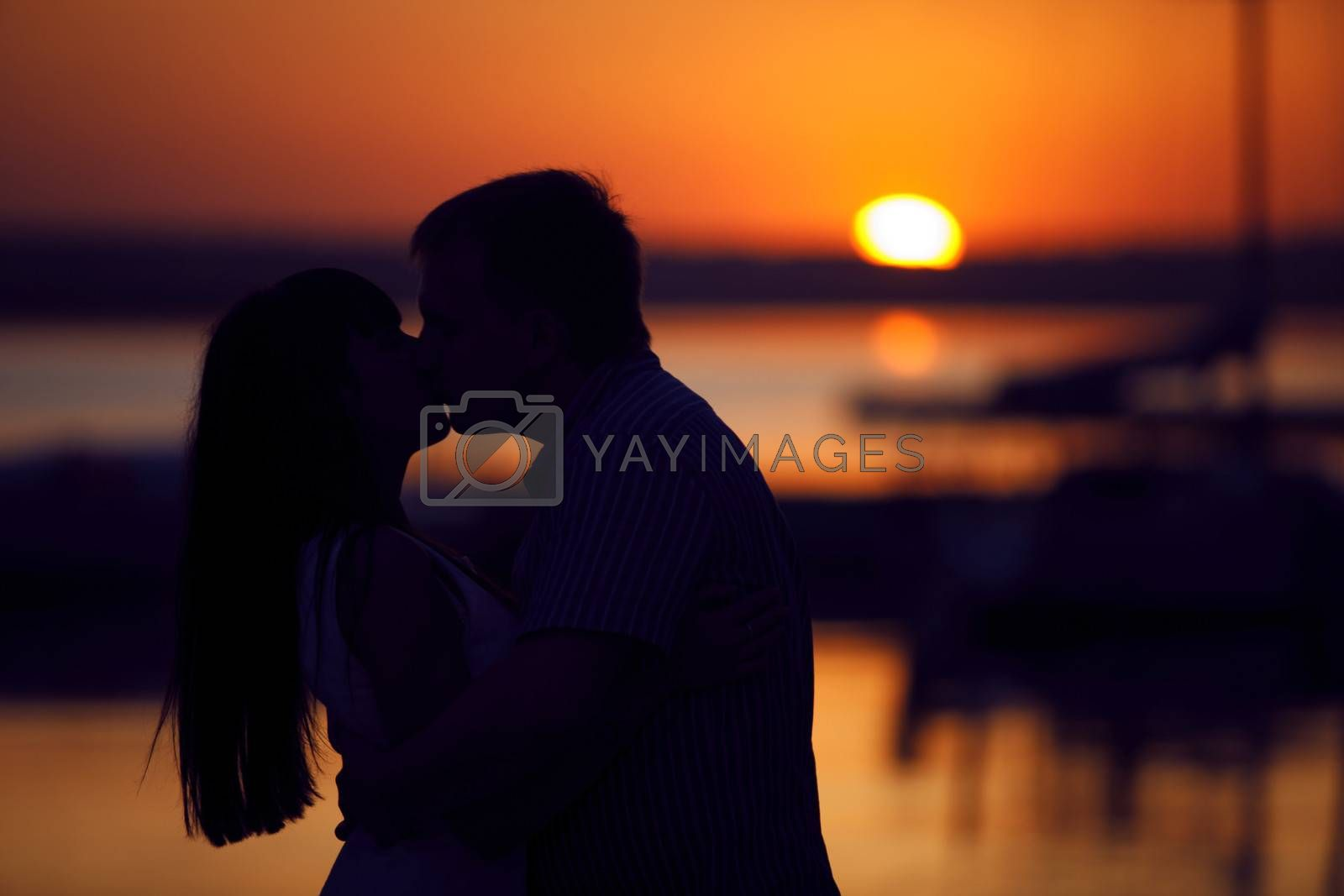 kissing couple in sunset