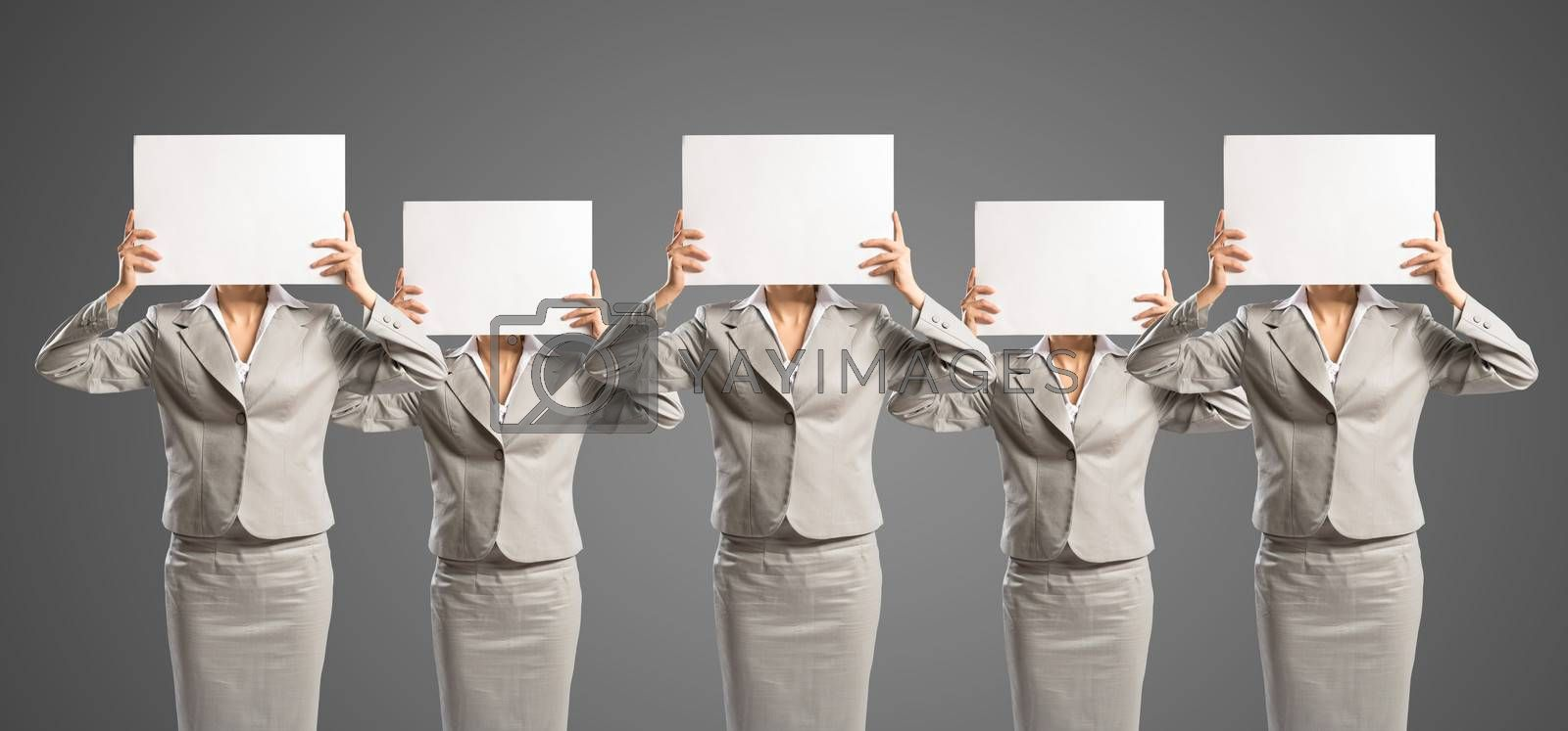 image of a businesswomen standing in a row by adam121