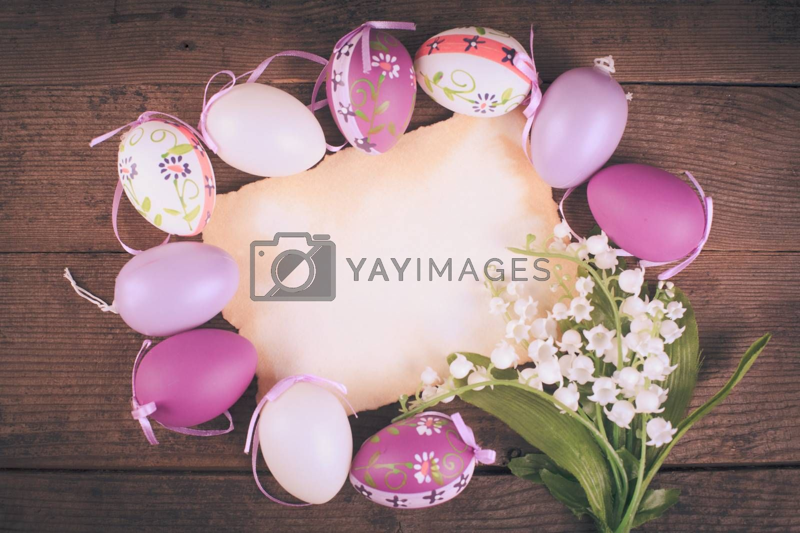 Purple and white eggs and empty greeting card. Easter decorations