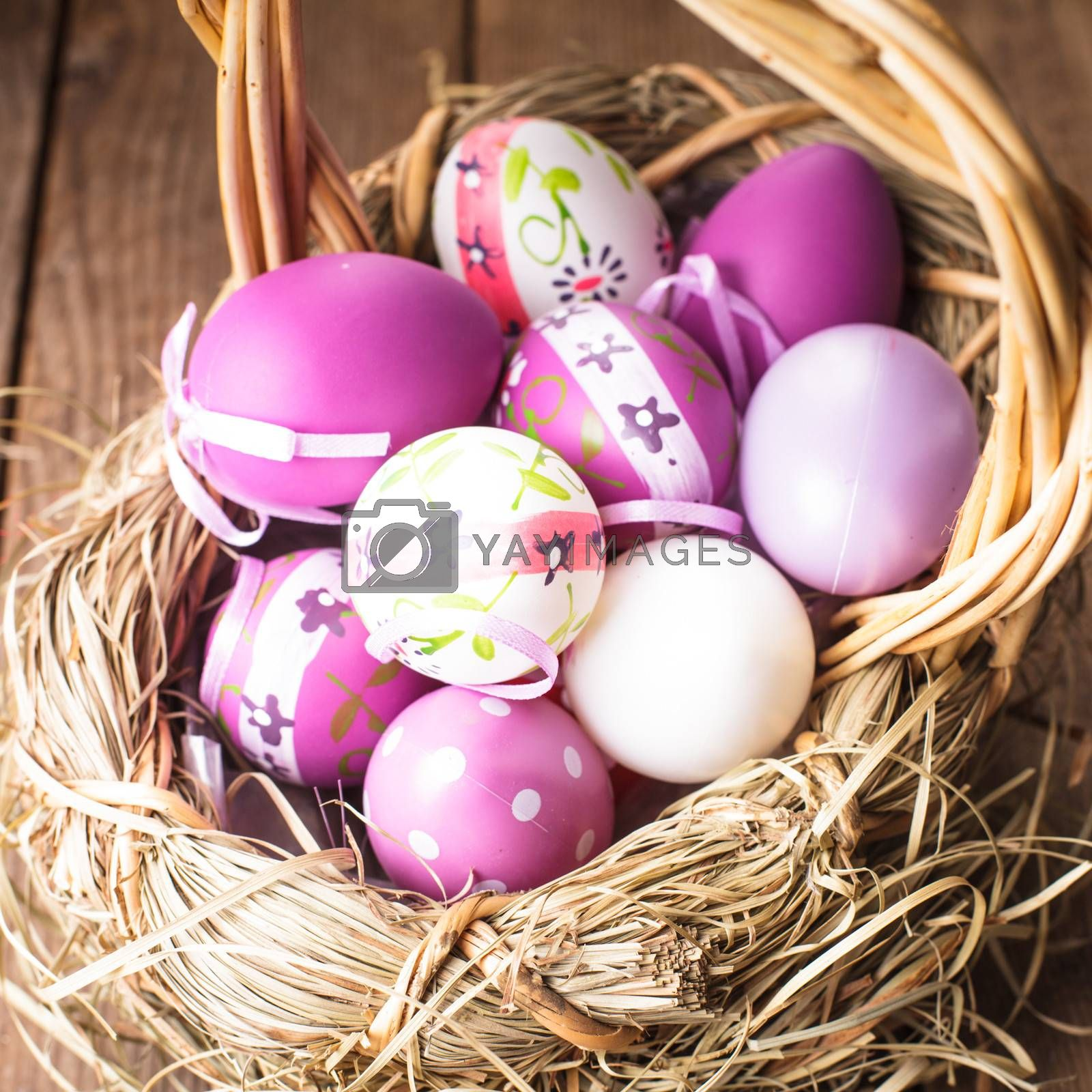 Various purple eggs in basket, Easter decorations
