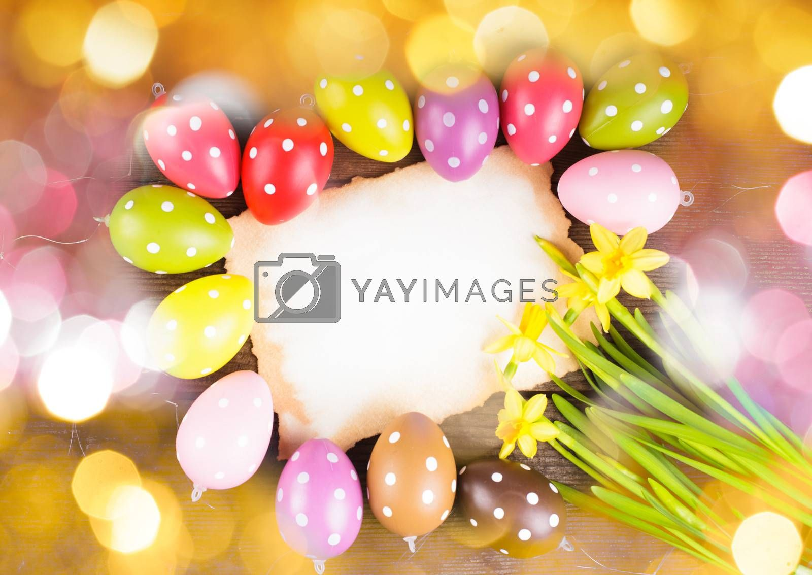 Colorful polka dot eggs and empty greeting card. Easter decorations