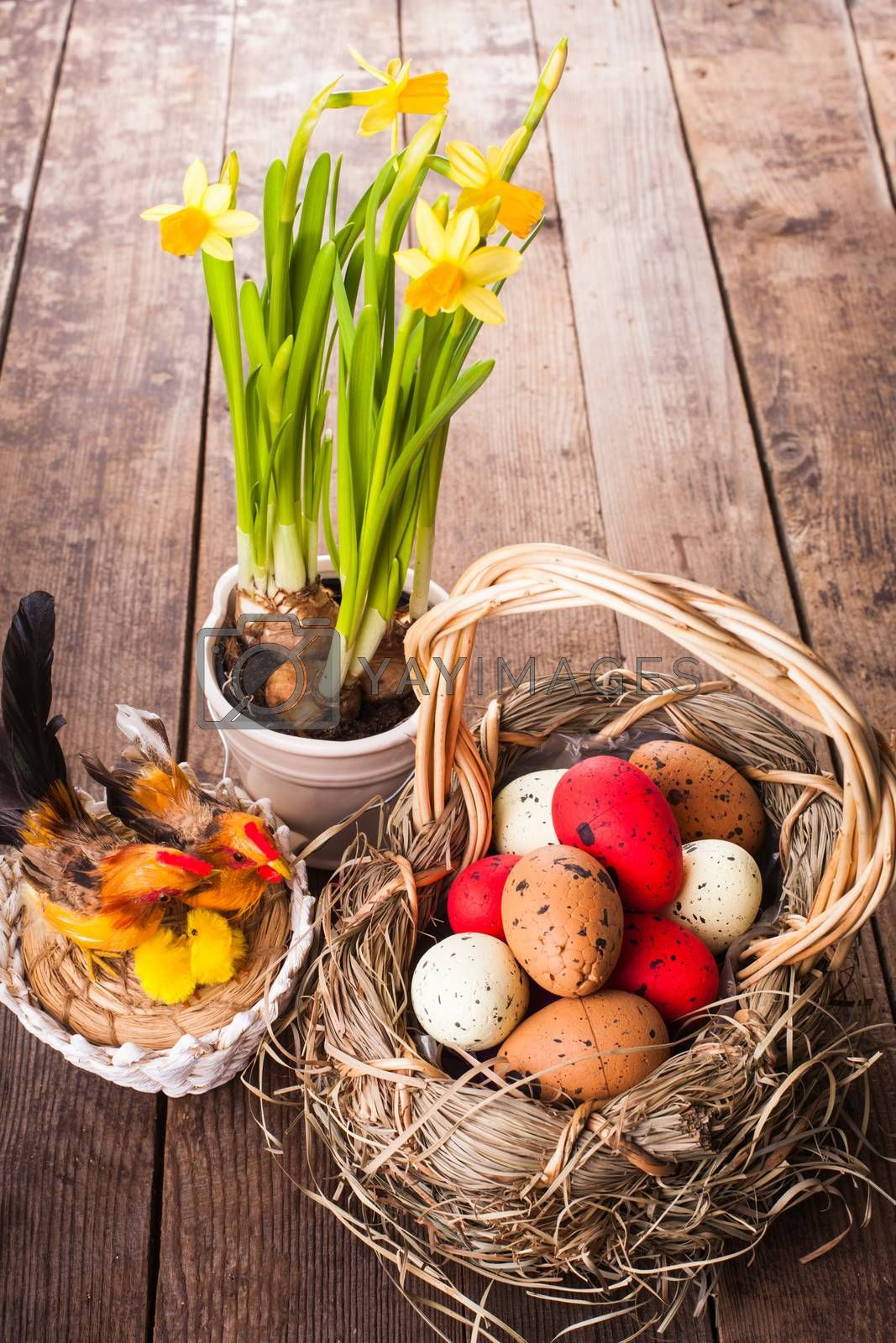 Brown, red and yellow eggs in basket, Easter decor
