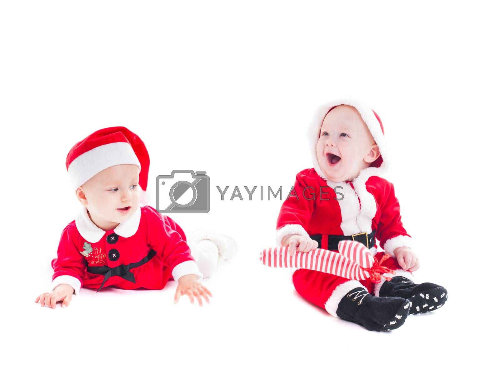 Adorable Santa babies - boy and girl isolated on white