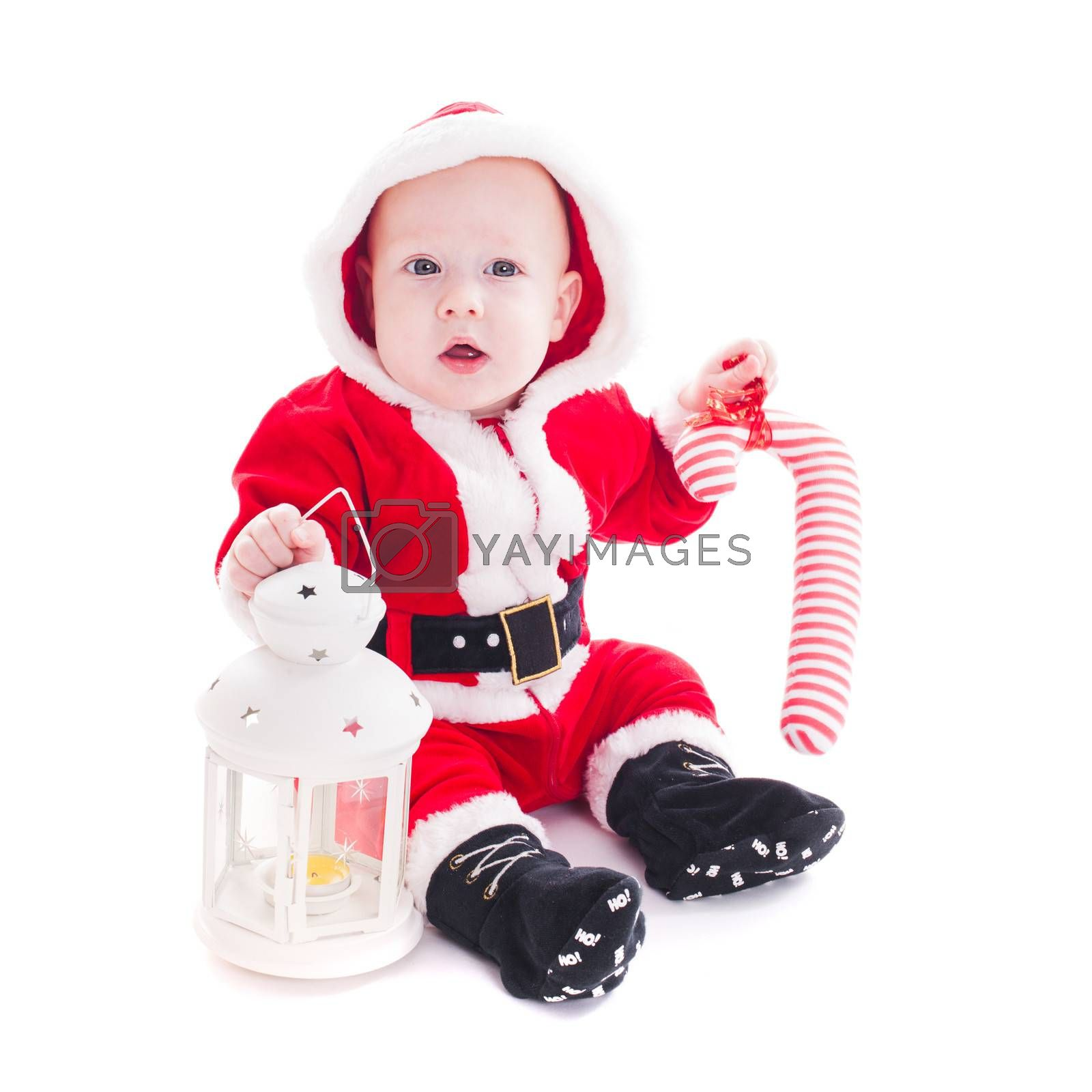 Little Santa boy with lantern and staff isolated on white background