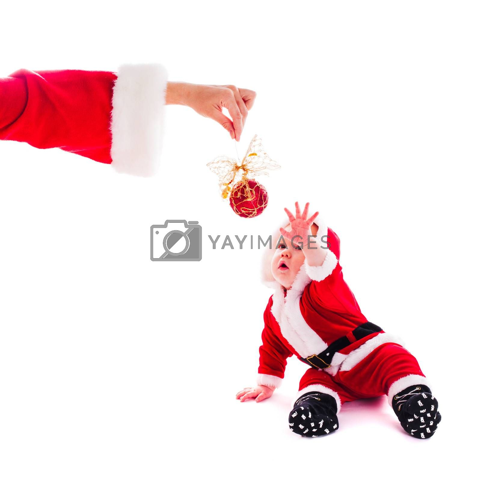 Little Santa boy wants to play isolated on white background