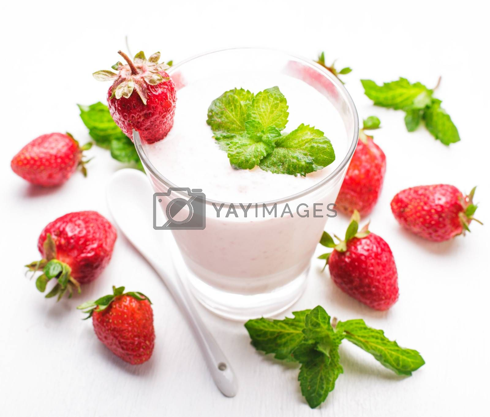Strawberry yoghurt in glass on the white table