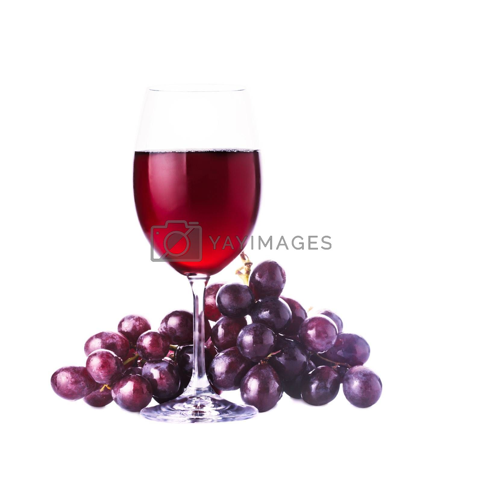 Glass of red wine and grape isolated on white