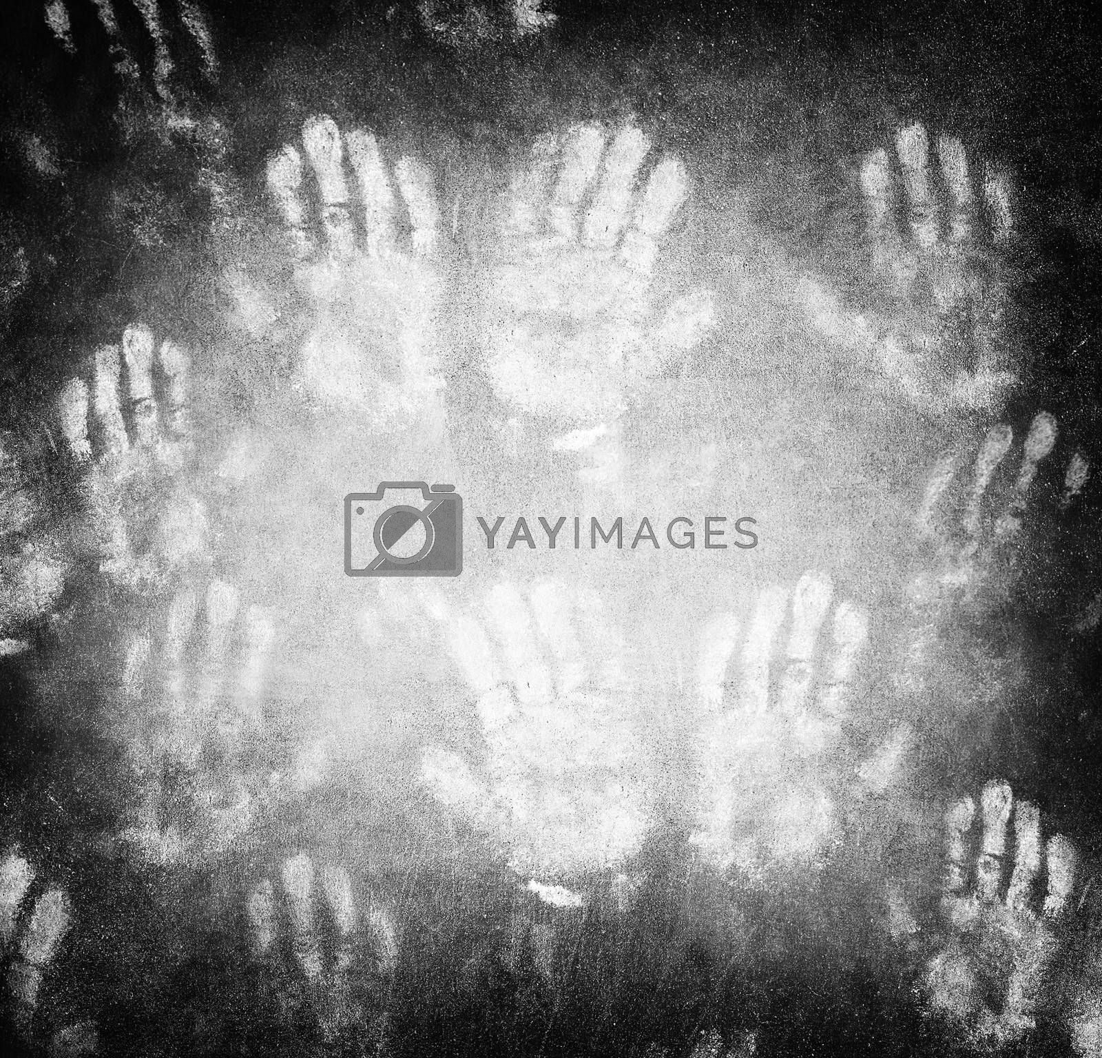 Imprint of human hands, black horror background, conceptual image of war and poverty, need help and protection concept