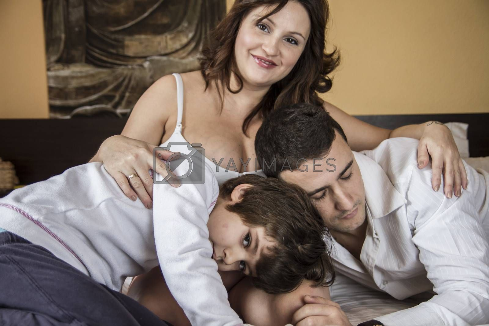 Happiness, Family With Pregnant Mother Relaxing On bed Together