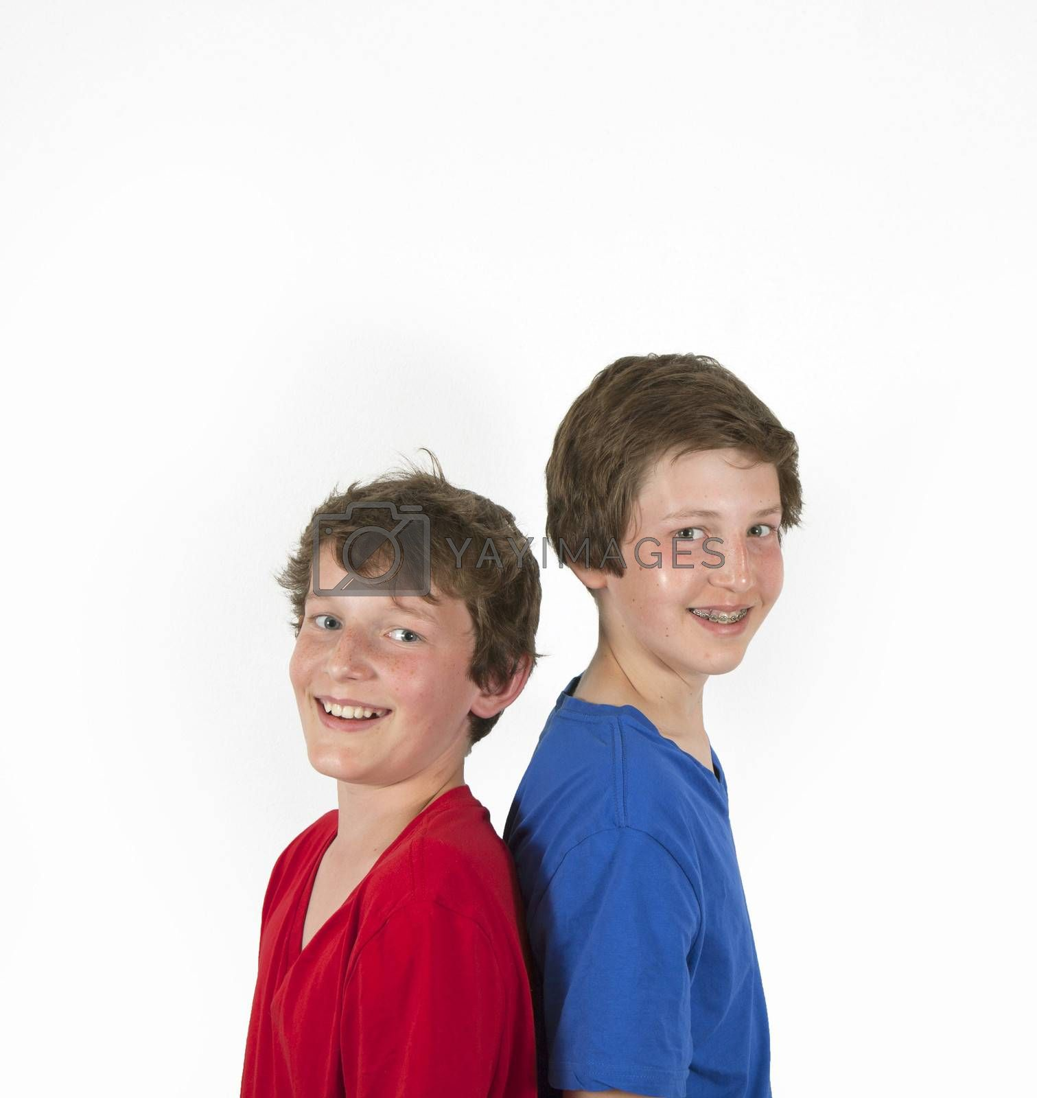 teenage brothers in red and blue shirt hugging and posing by meinzahn