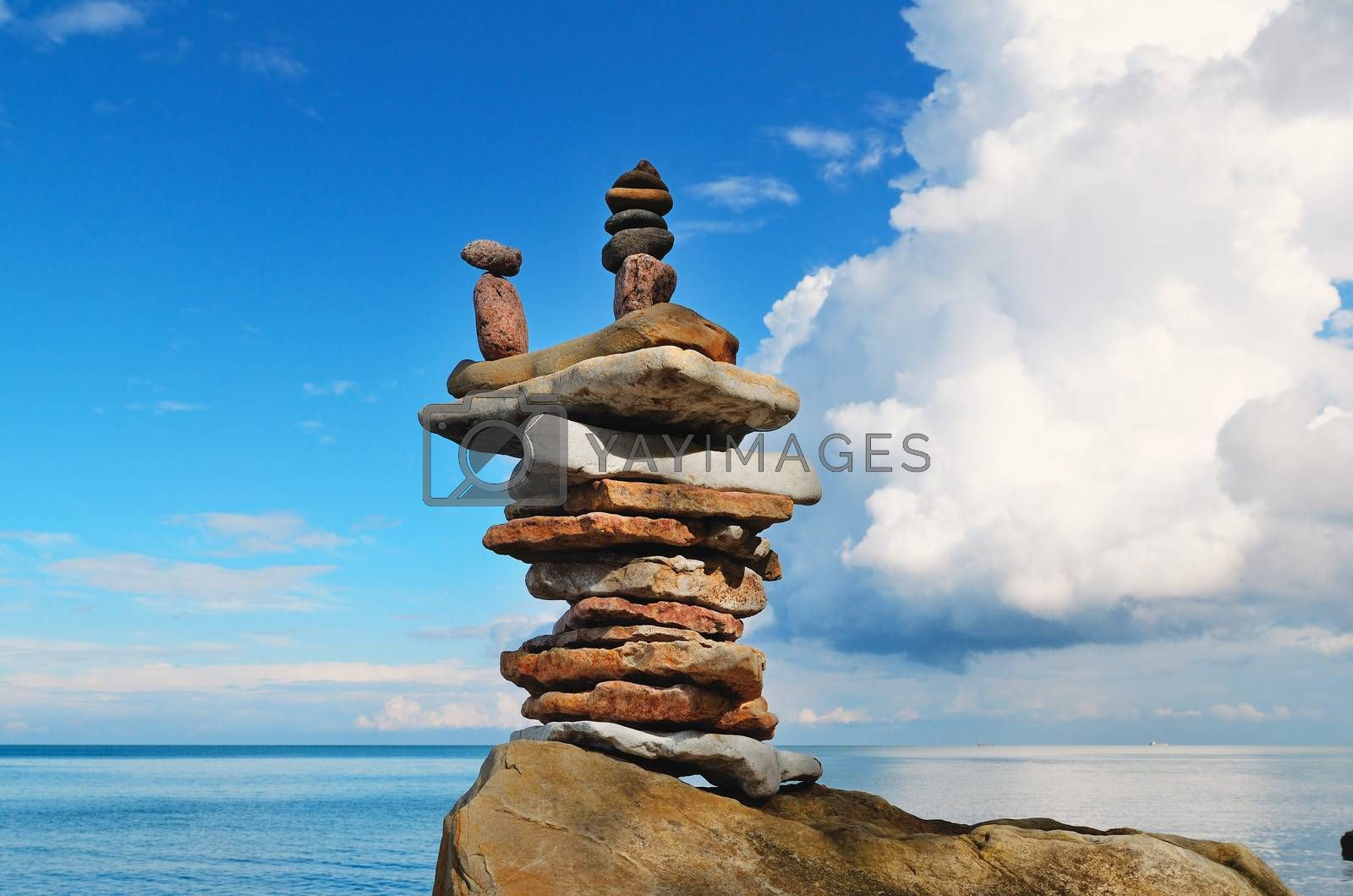 Pyramidal stack of pebbles on the coast