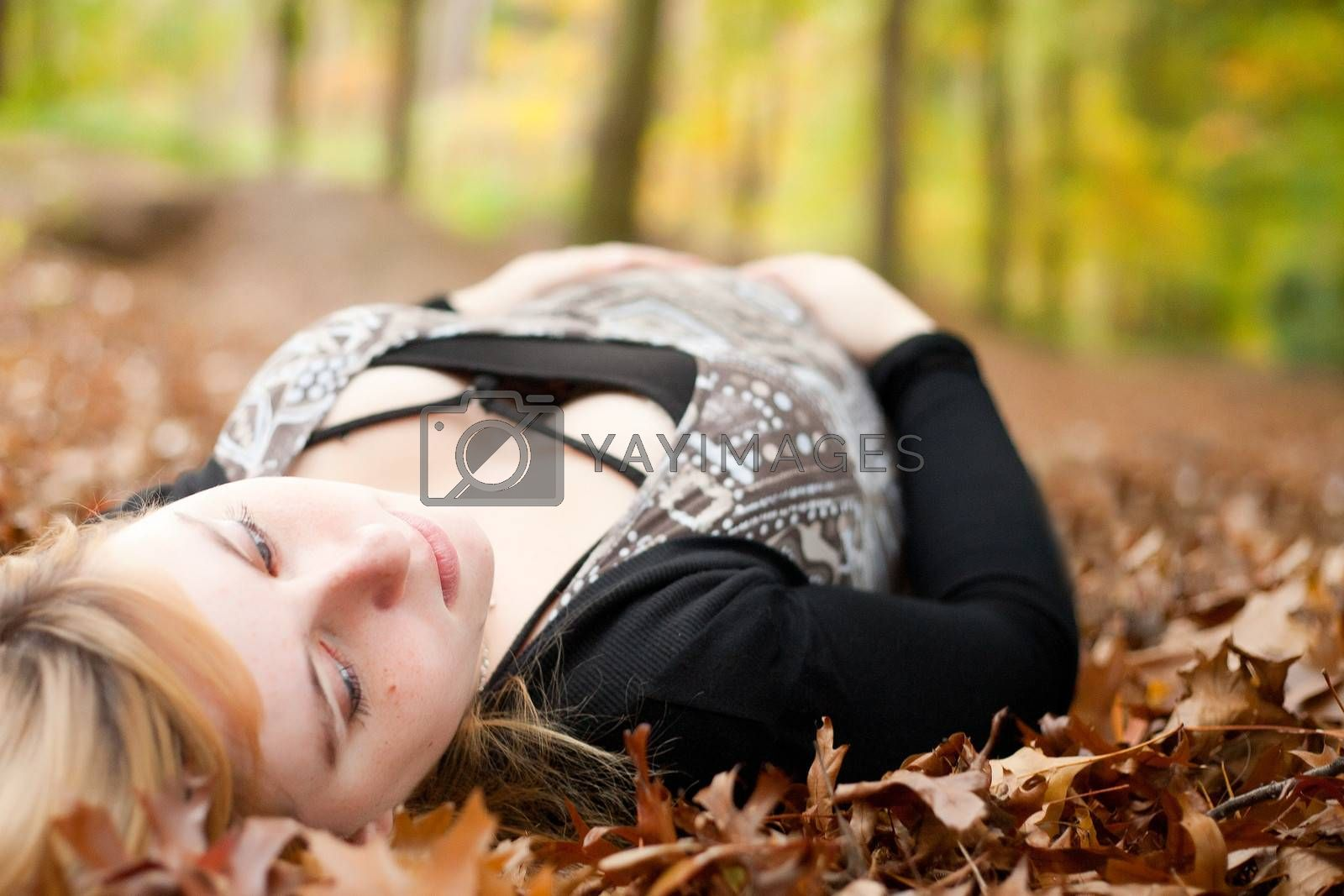 Blond young girl is waiting for her little child. Shoot in the forest