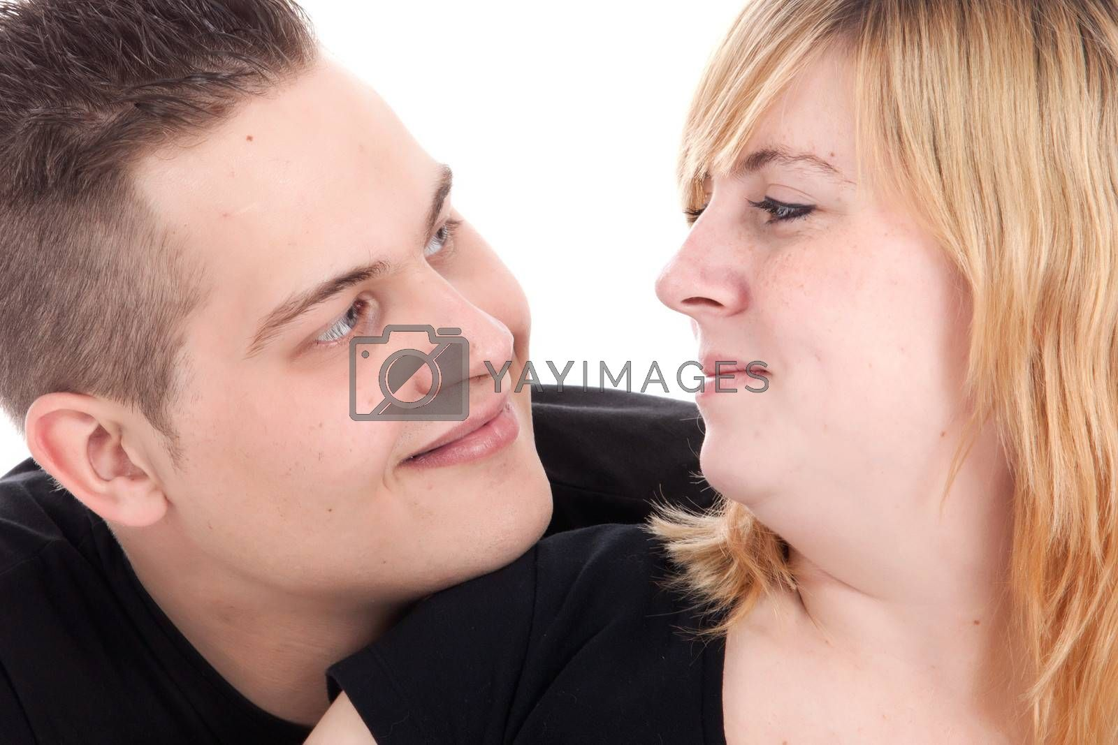 Happy young pregnant couple in the studio