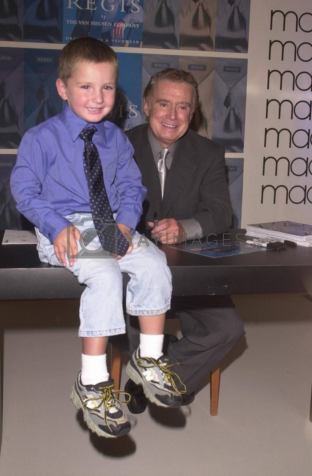 Regis Philbin and Young Fan at Robinson's-May in Beverly Hills to promote new clothes line. 08-23-00