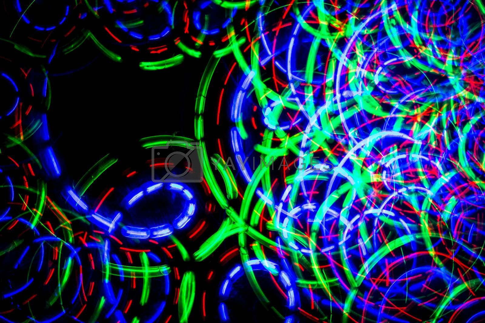 Lines and circles of colored light forming chaos