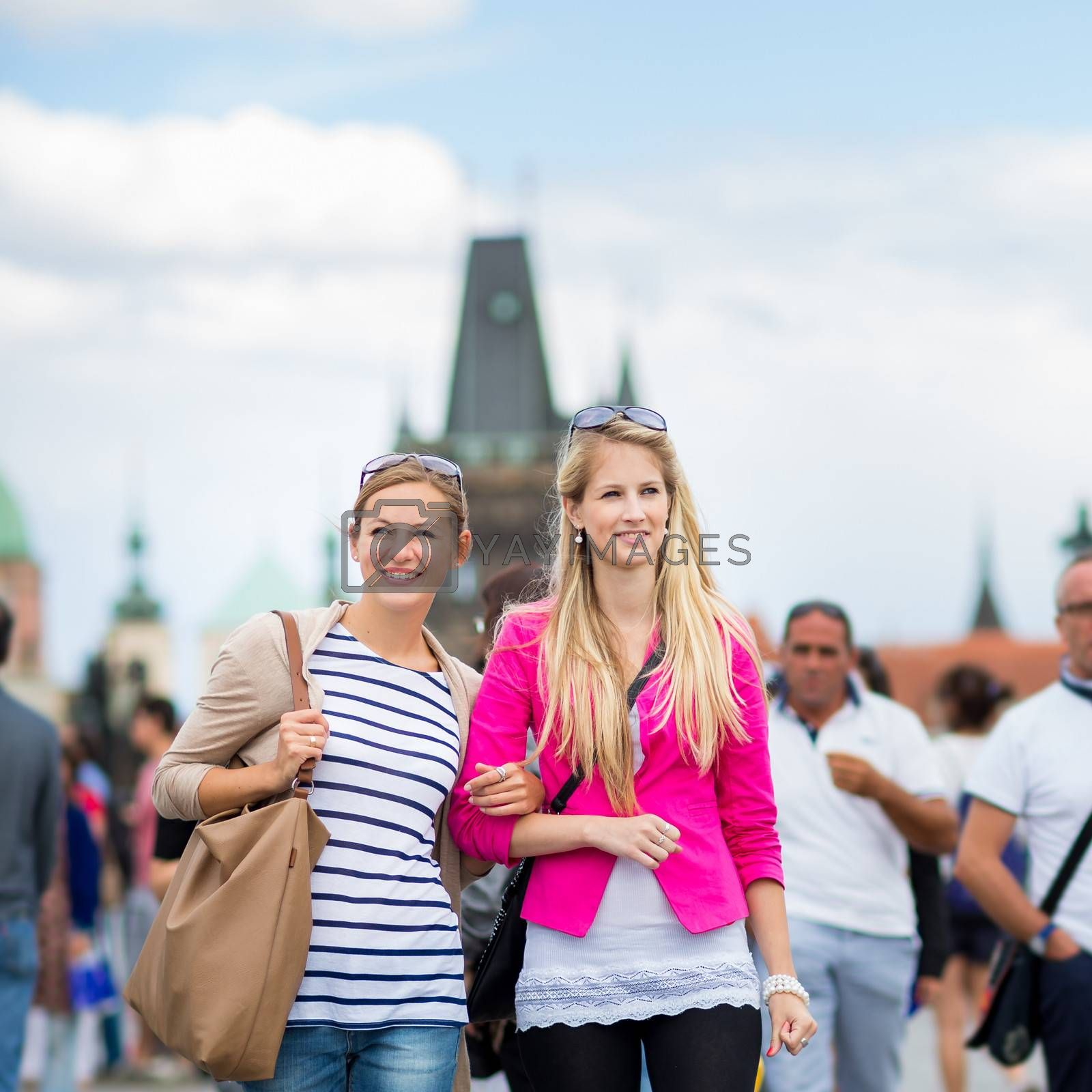 Two pretty, young women sightseeing in Prague historic center by Viktor Cap