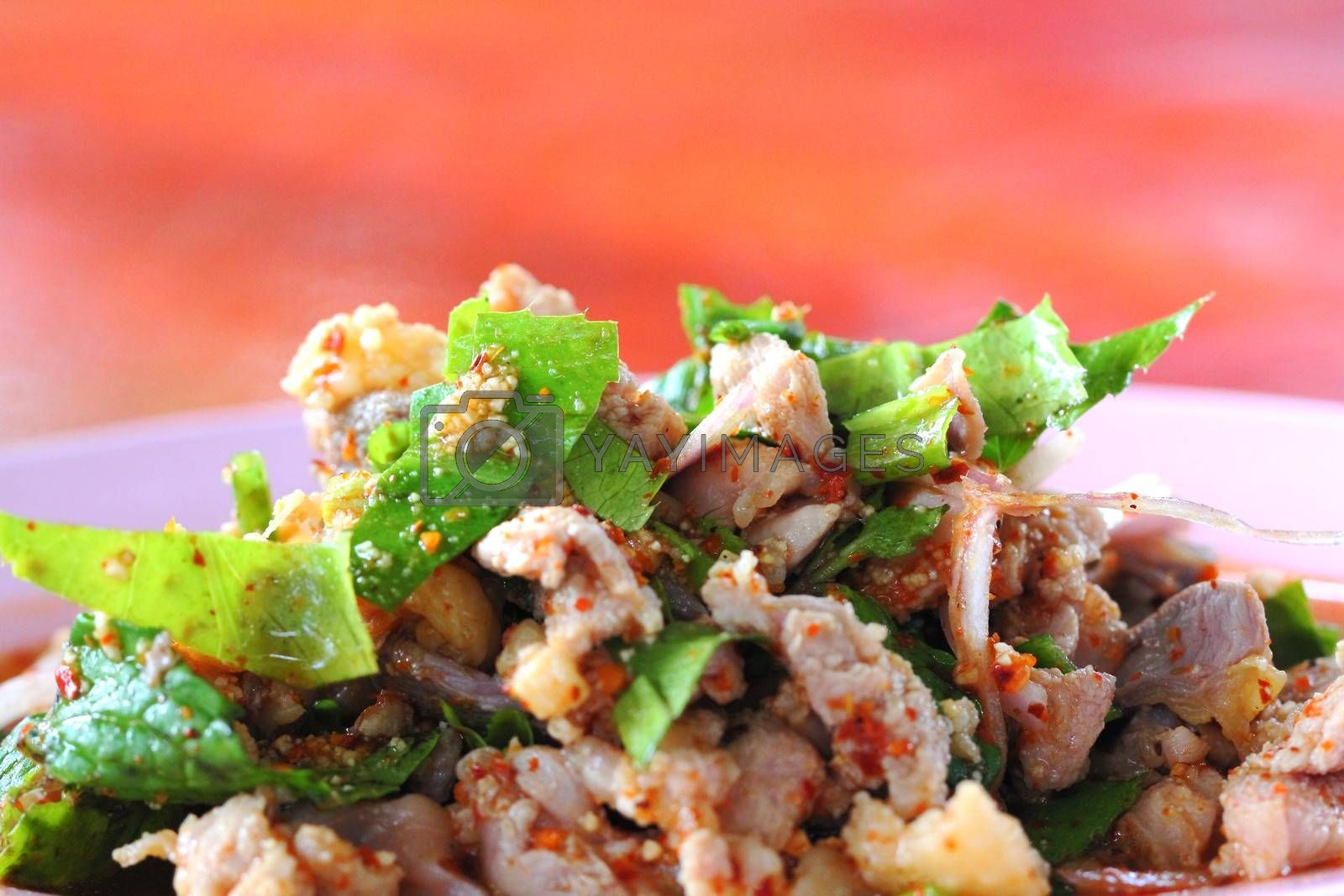 Spicy minced duck salad with green vegetables and chillies