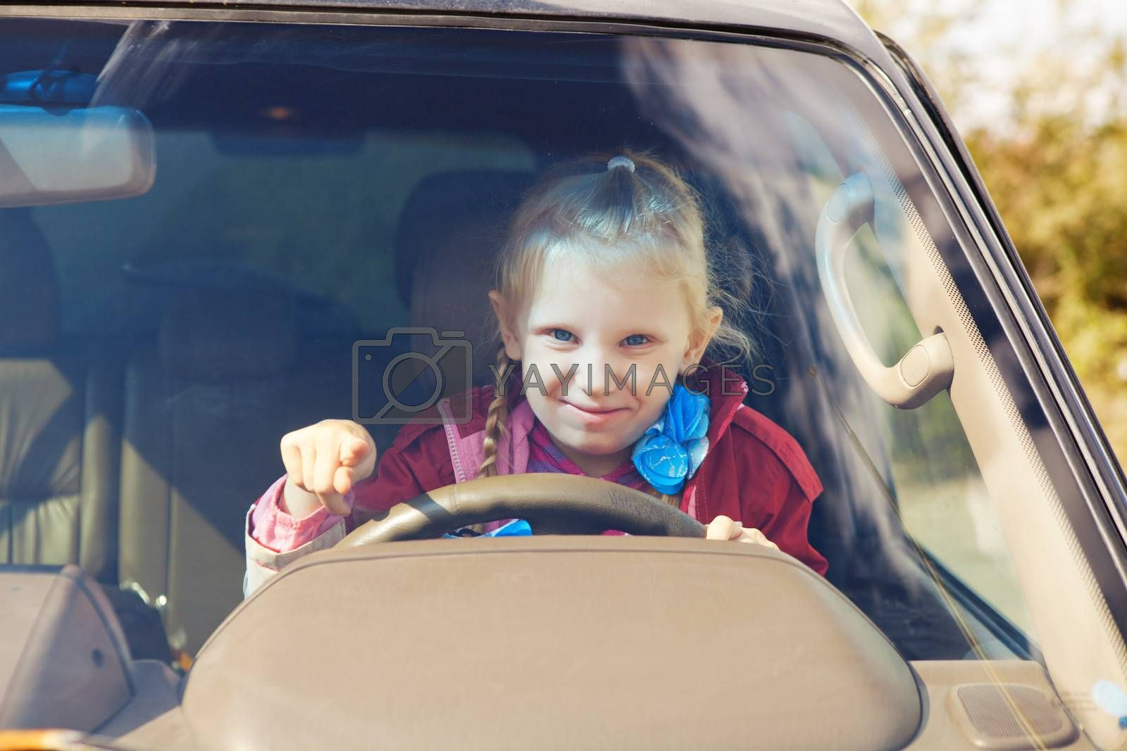 small girl driving a car