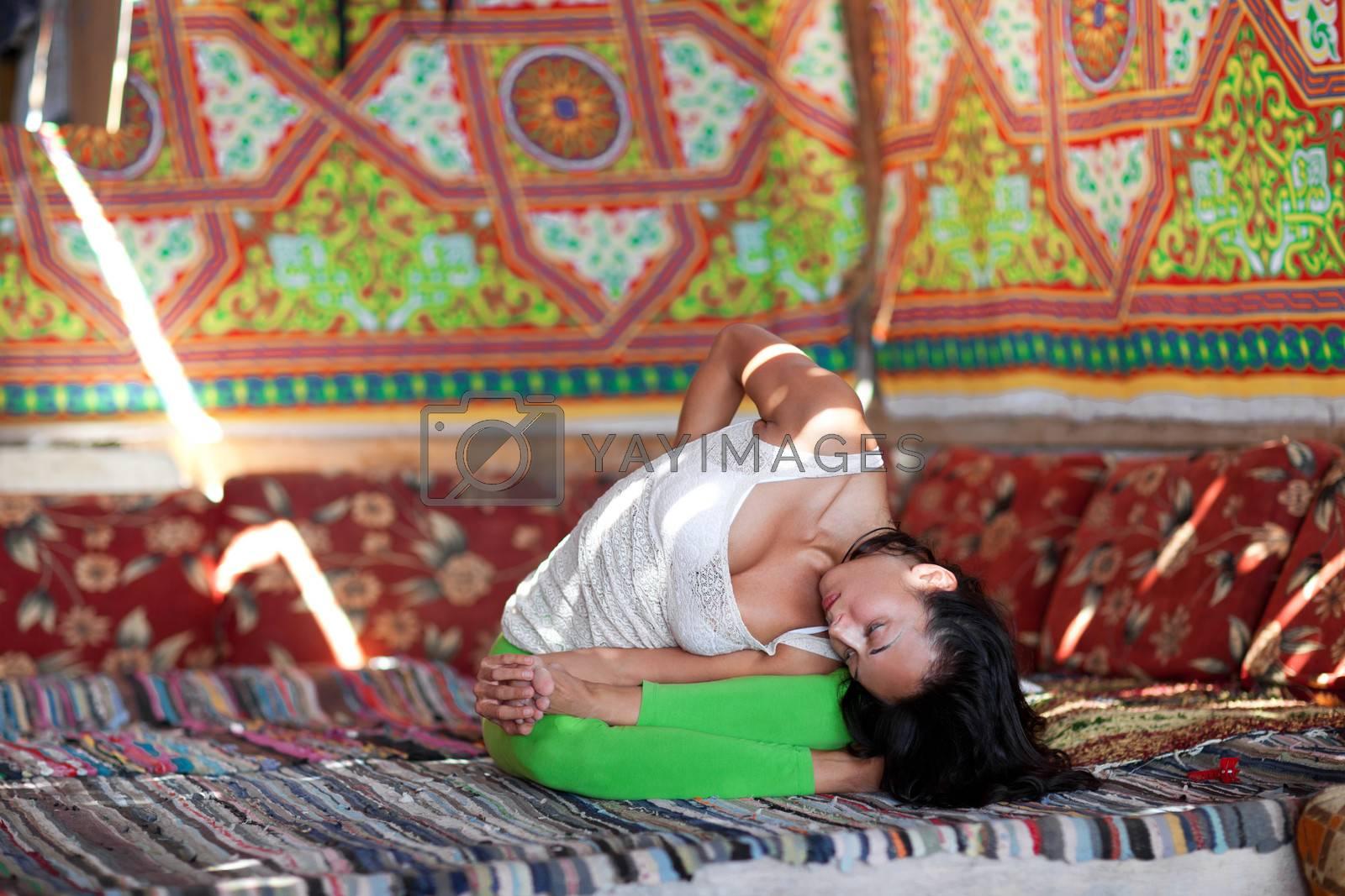 girl doing yoga indoors