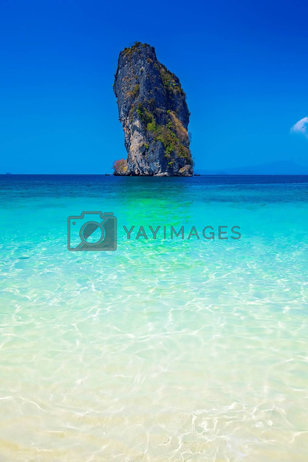 Poda Island surrounded by blue skies and crystal clear water