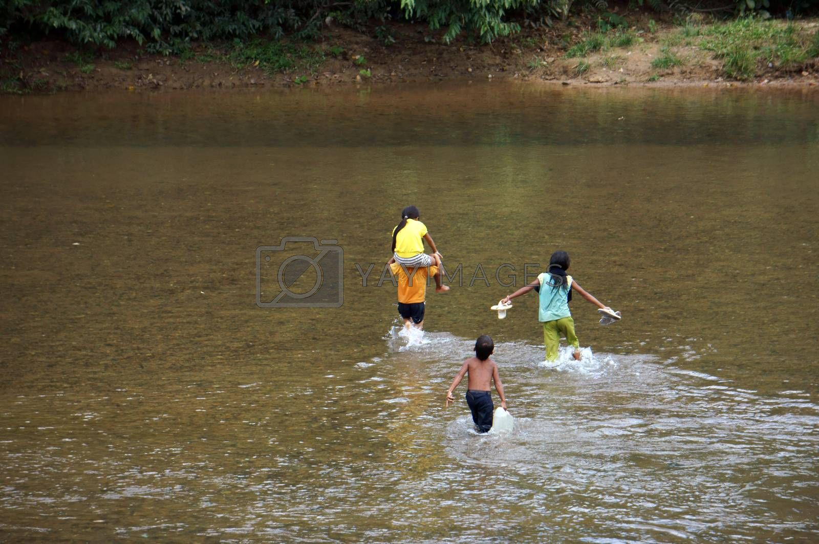 KHANH HOA, VIET NAM- FEBRUARY 5: Chidren  across a stream, this is warning about  children's drowning  situation at countryside, Khanh Hoa, February 5, 2013