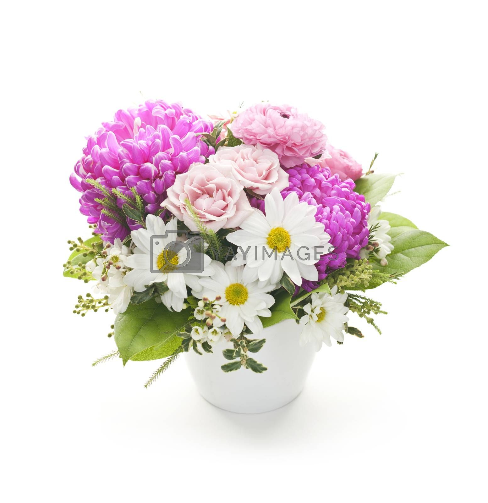 Bouquet of colorful flowers arranged in small vase on white background