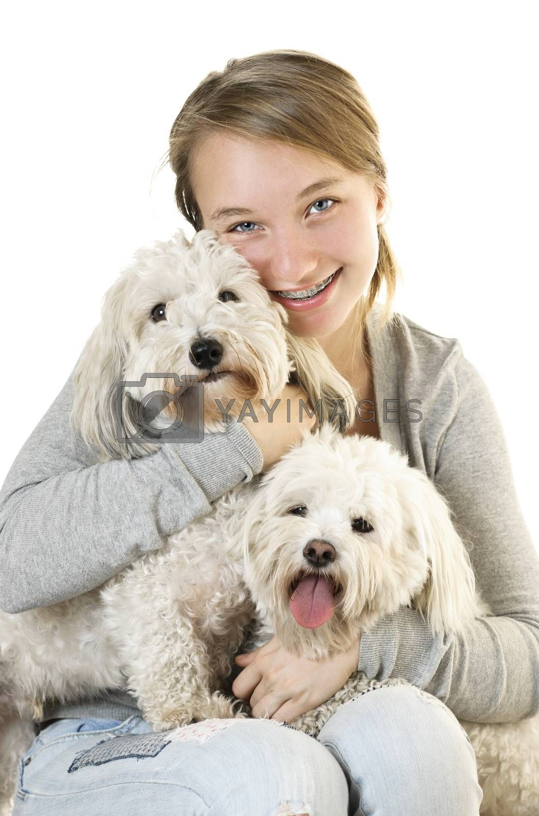 Pretty teenage girl holding two adorable coton de tulear dogs