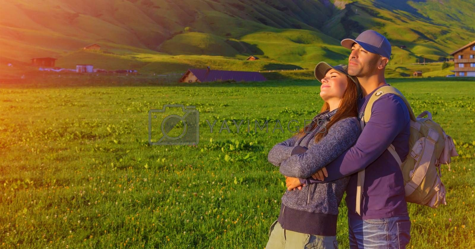 Loving couple enjoying sunset in the mountains, Alps, Austrian mountain, summer adventure, active family, romantic travel in Europe
