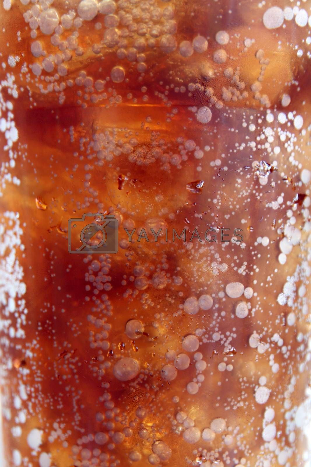 Zoom Picture of Cola drinks in plastic cup and tube to eat on the table.