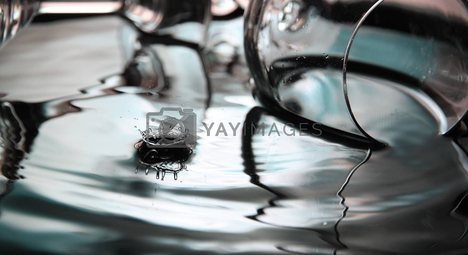 Closeup Pictures Blue color and glass Background of Water drops a beautiful shape in Basin.