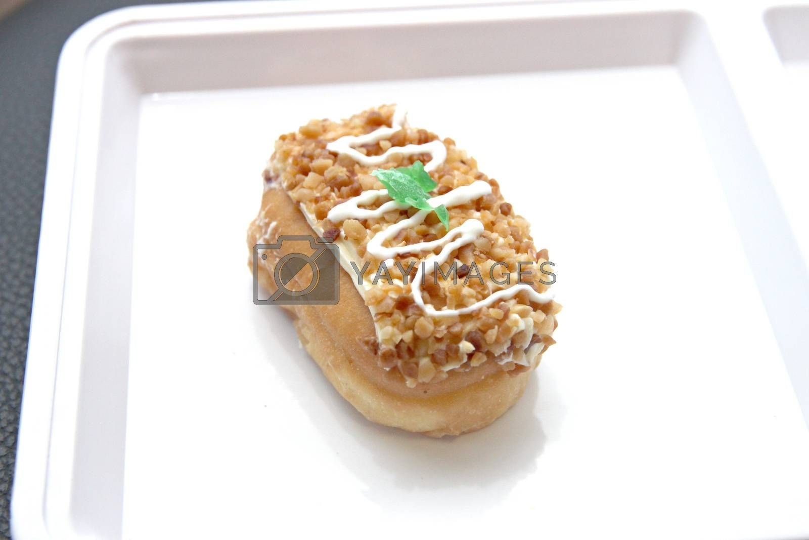 The dessert of Donut like sushi on white dish.