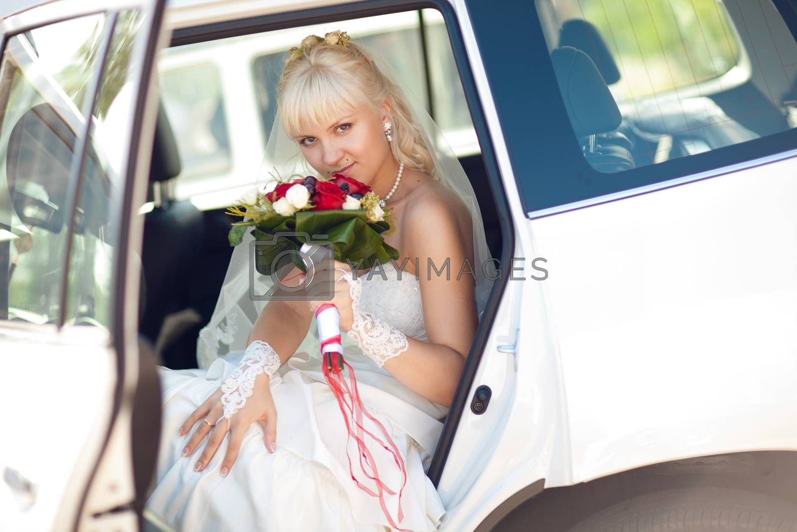 portrait of the bride in car