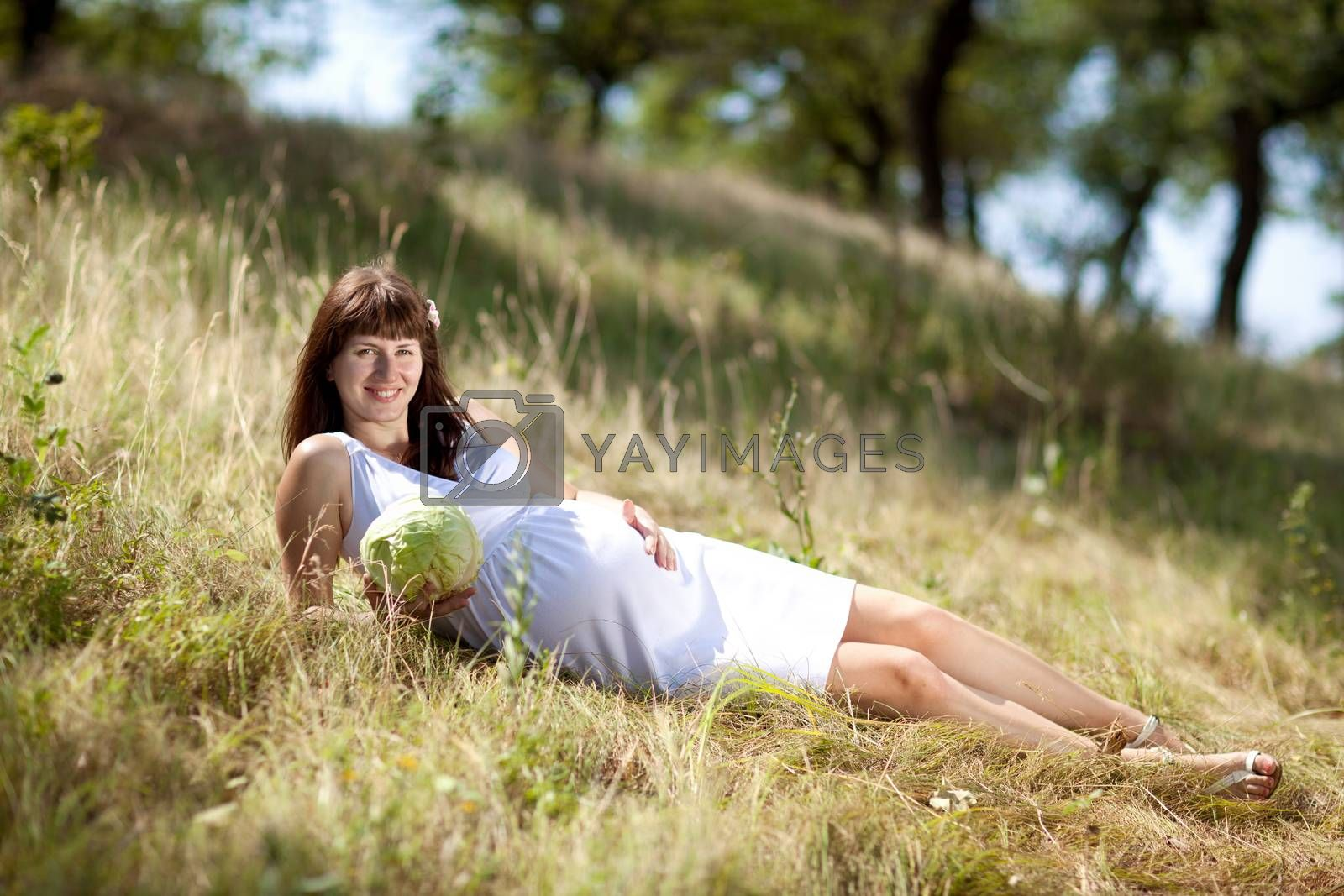 young fashion pregnant girl in a long dress