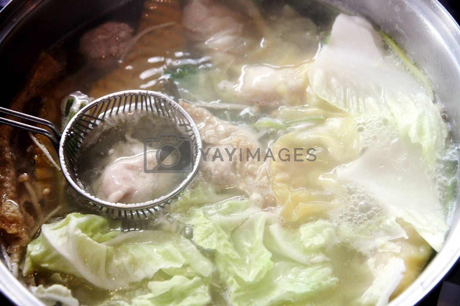The Picture Pork slide in sukiyaki pot.