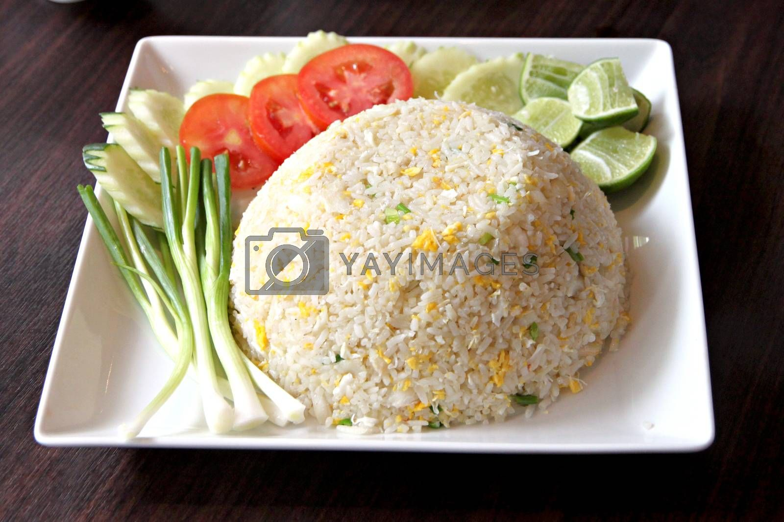 The Picture focus Fried rice in white dish on the Foods table.