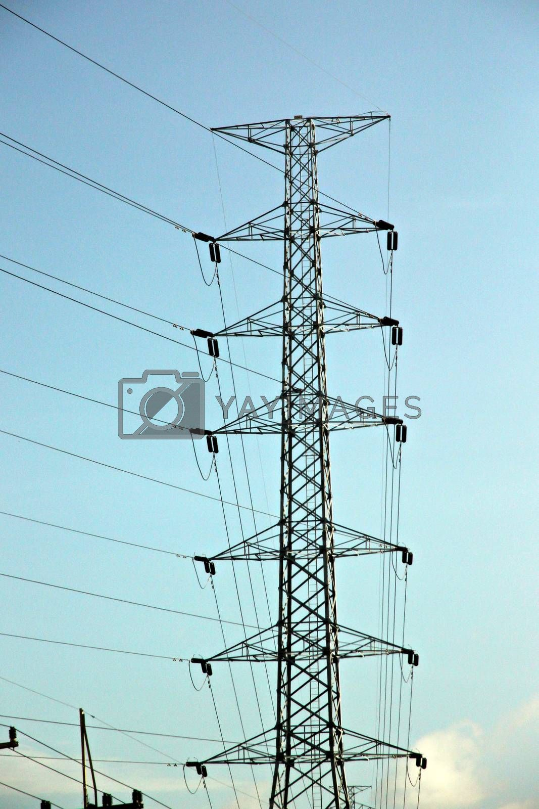 High voltage electrical transmission towers. by PiyaPhoto