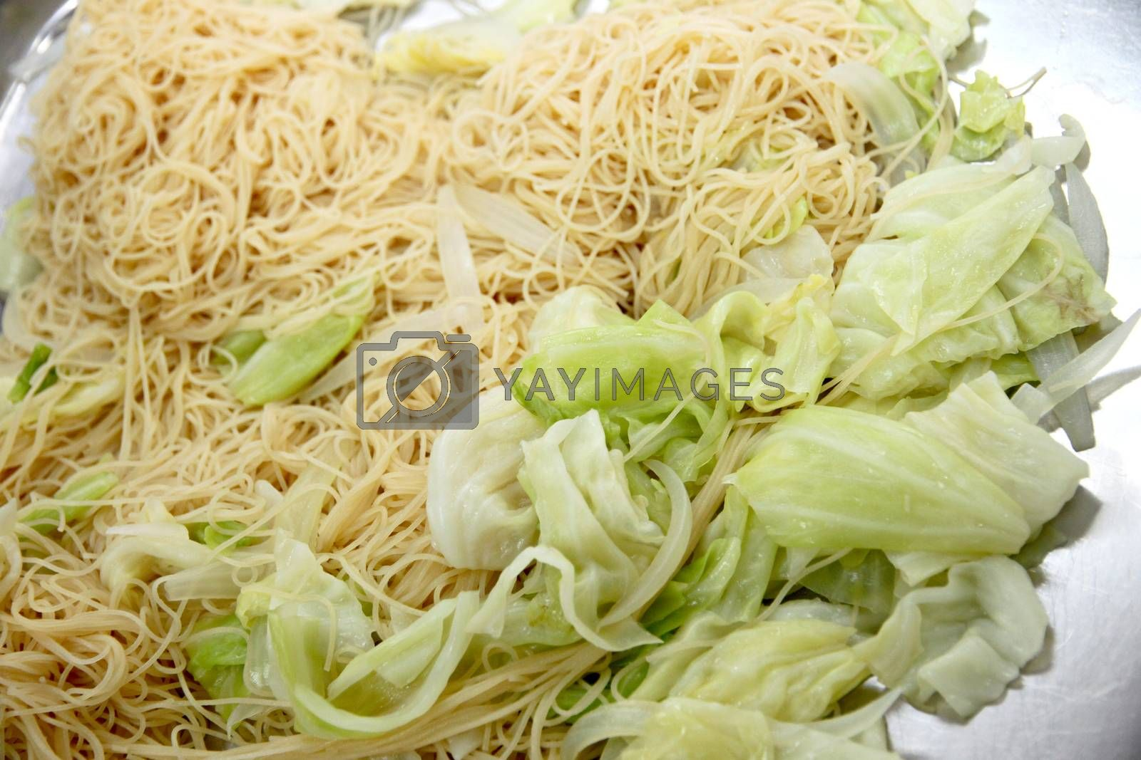 The Picture of Noodles mixed with vegetables in a pan.