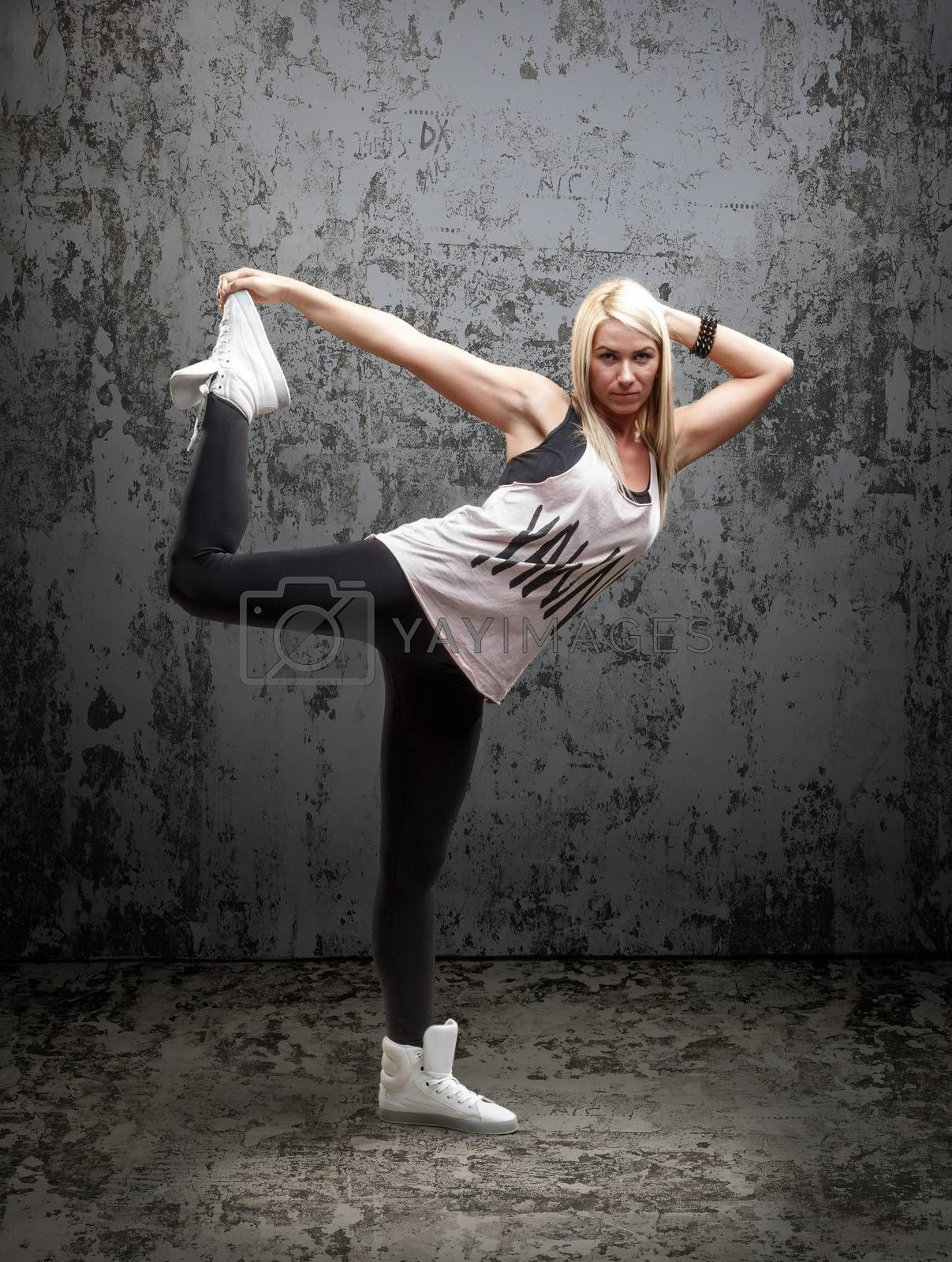Urban hip hop dancer with grunge concrete wall background texture