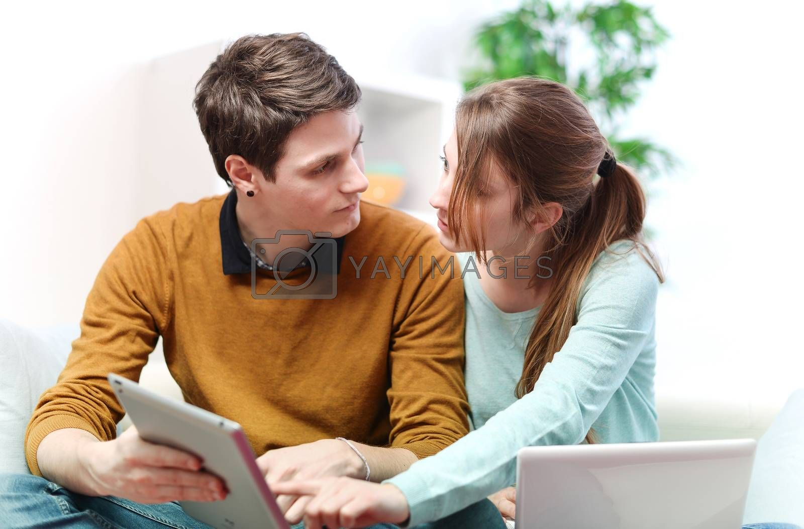 Attractive couple consulting something on a touchpad