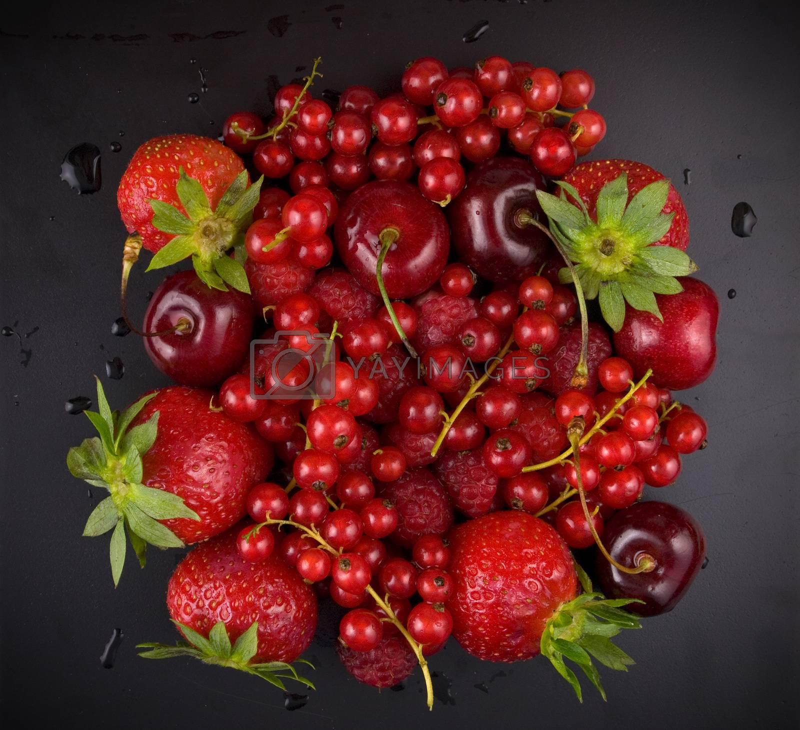 fresh red  fruit on black background