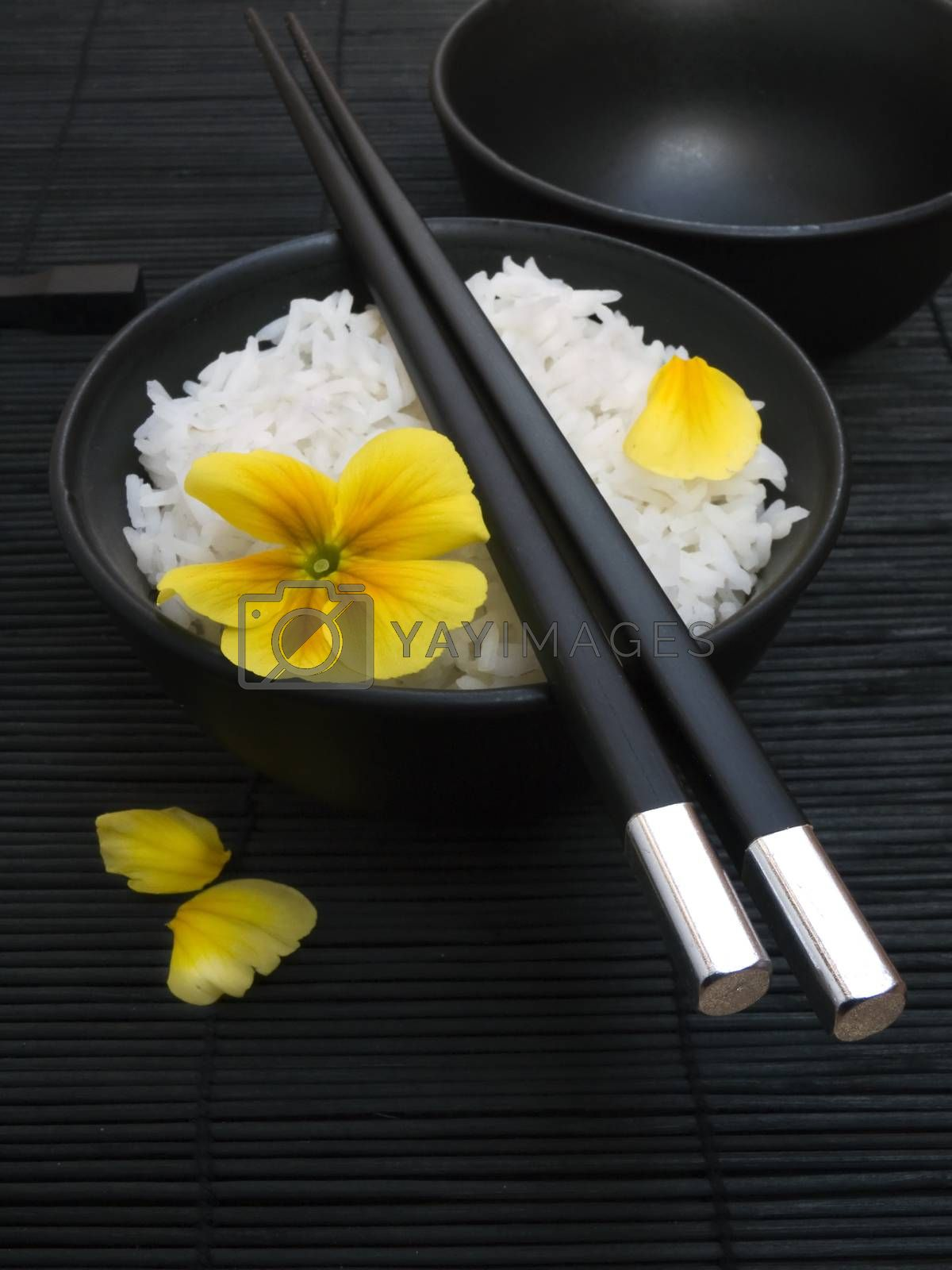 asian rice with yellow flower and chopsticks