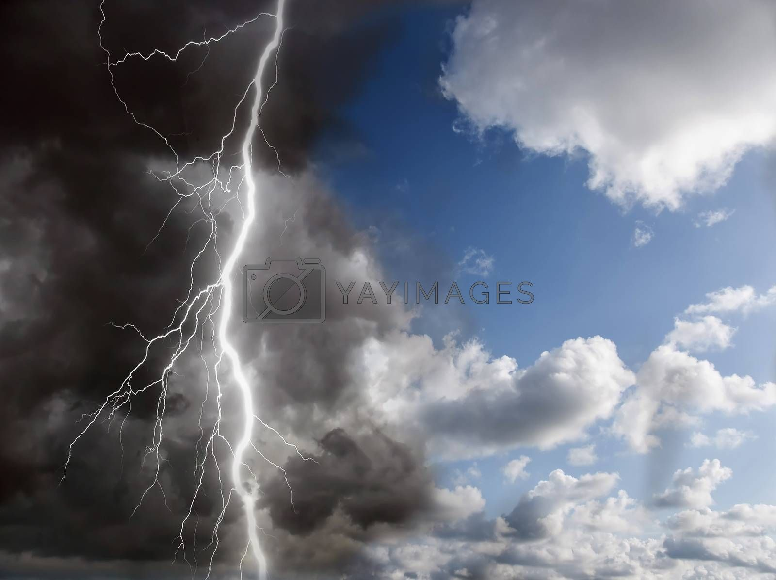 blue sunny sky and black clouds with lightning