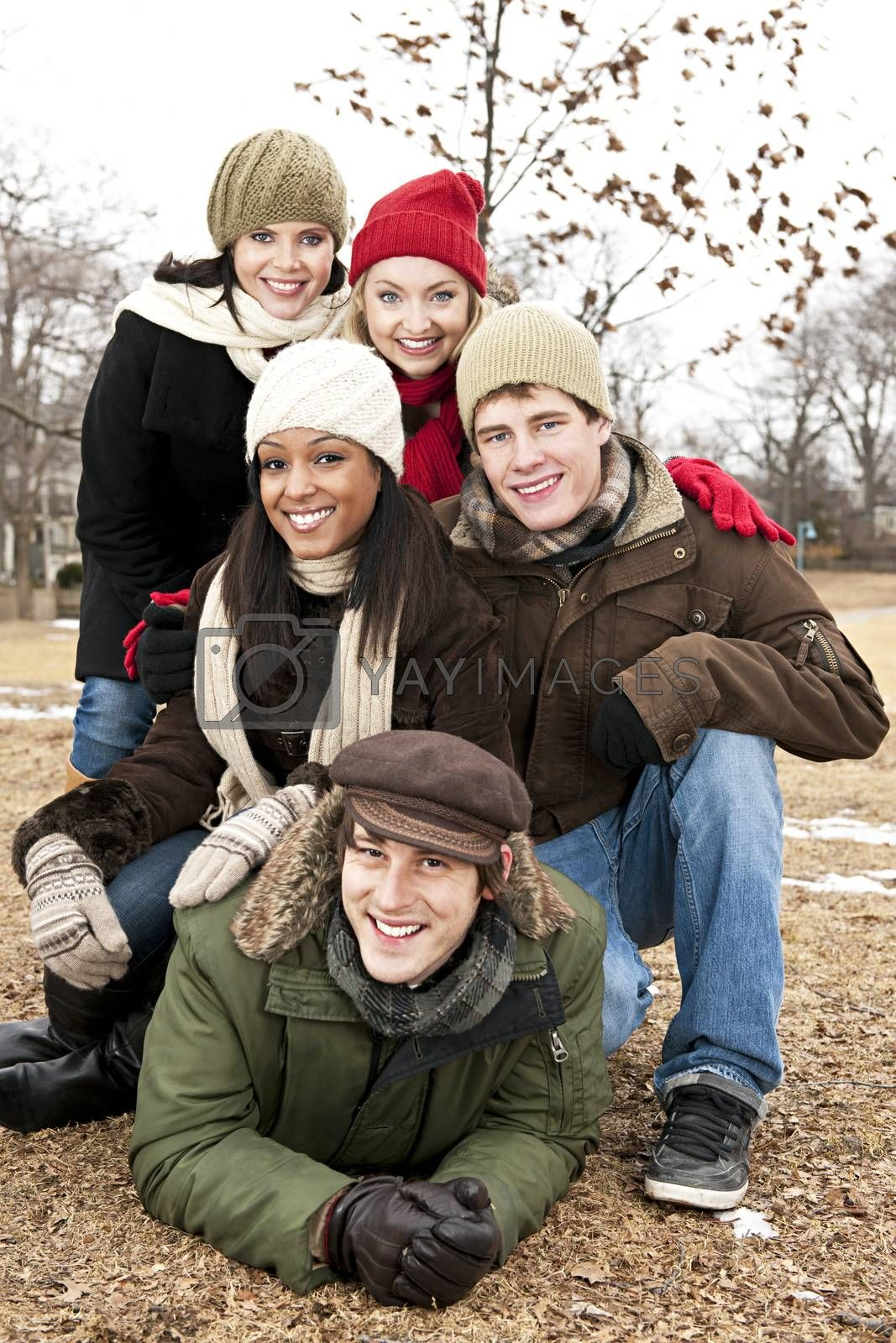 Group of young friends having fun outdoors in winter