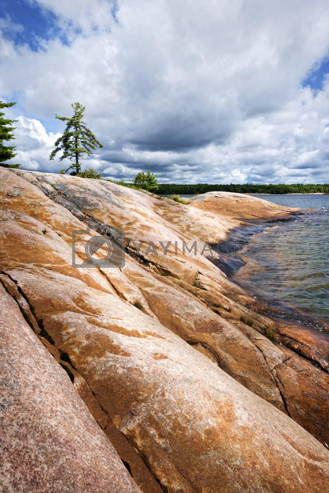 Smooth rocky lake shore of Georgian Bay in Killbear provincial park near Parry Sound, Ontario, Canada.