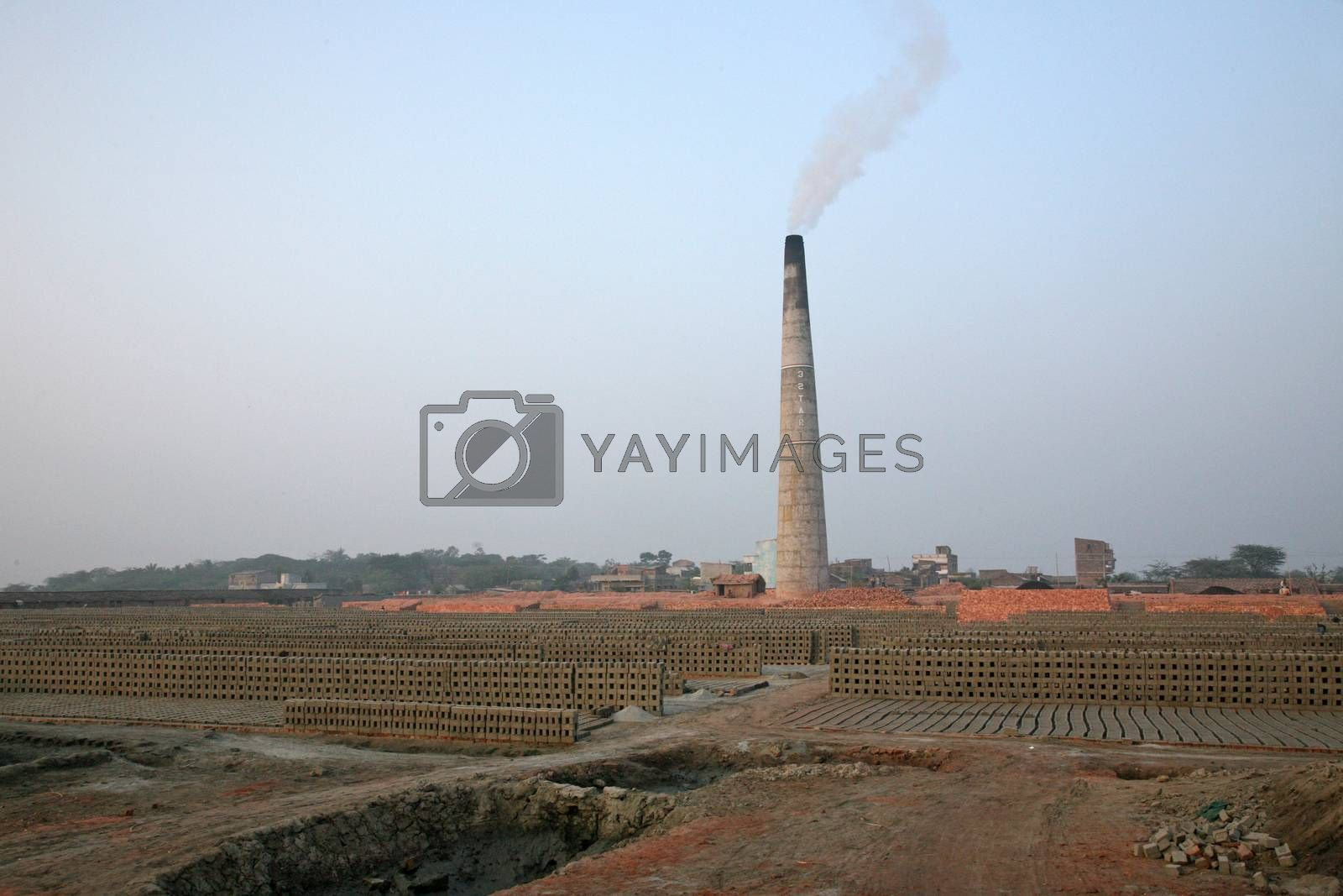 A Brick field is a large landed area, used for manufacturing bricks from mud, soil, clay and sand. Tools and machines for making bricks are very rudimentary, January 14, 2009 in Sarberia, West Bengal, India.
