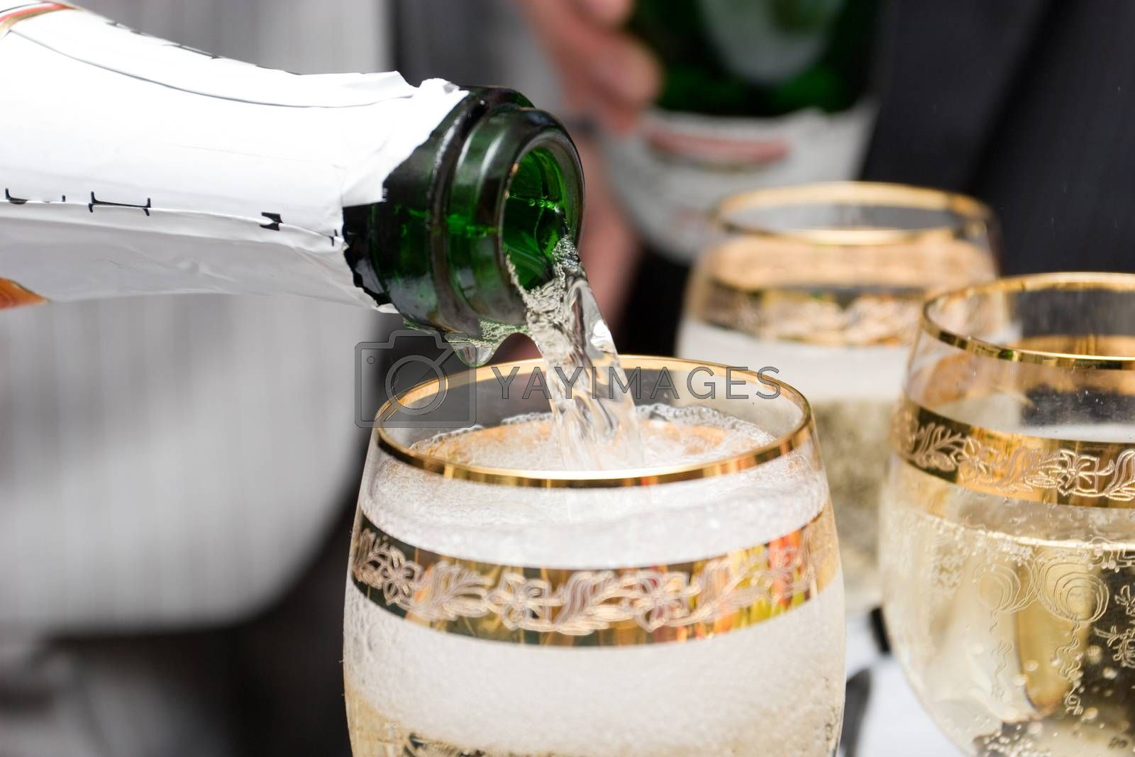 pouring champagne in glasses